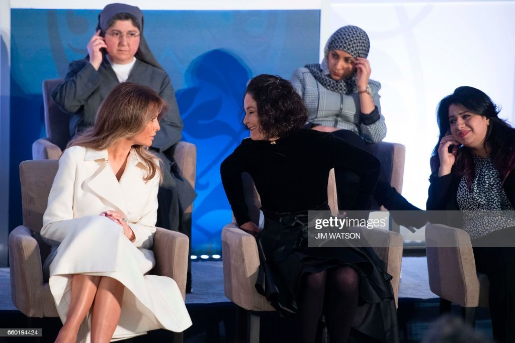 First Lady Melania Trump speaks with acid burn victim Natalia Ponce de Leon of Colombia during the International Women of Courage ceremony at the State Department in Washington, DC, March 29, 2017. /