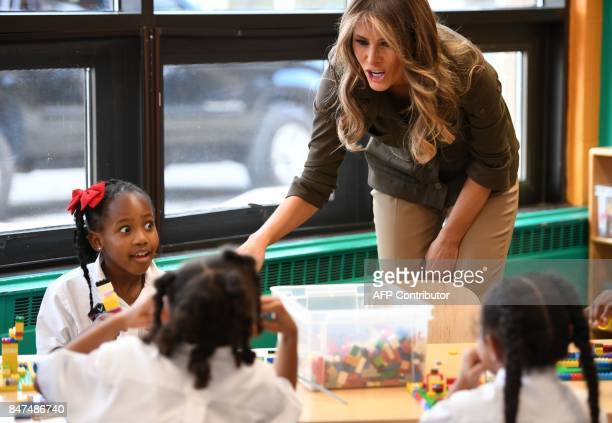 US First Lady Melania Trump speaks with students as she visits a youth centre at Joint Andrews Airforce base Maryland on September 15 2017 / AFP...