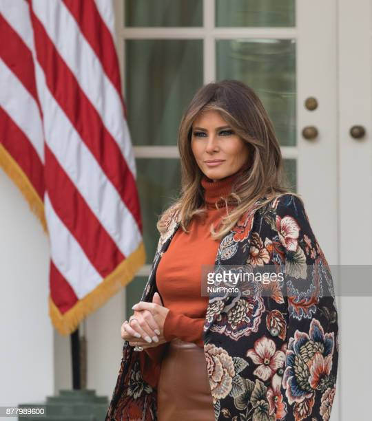 First Lady Melania Trump stands next to President Donald Trump as he speaks at the National Thanksgiving Turkey Pardoning Ceremony in the Rose Garden...
