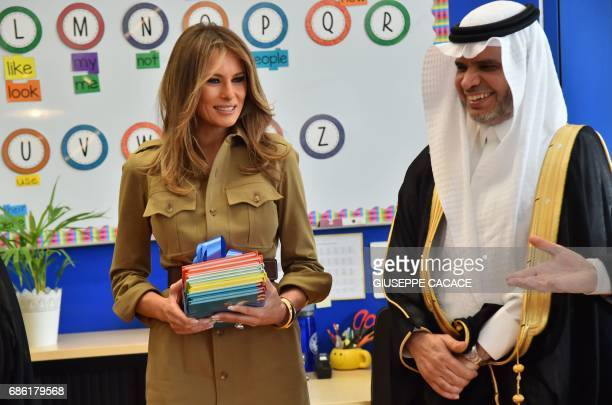 First Lady Melania Trump stands next to Saudi Education Minister Ahmad alIssa during a visit to the American International School in the Saudi...