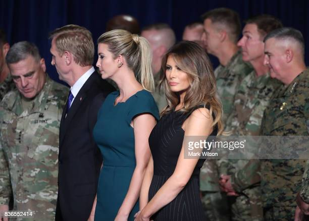 First lady Melania Trump stands with Ivanka Trump before President Donald Trump delivered remarks on American involvement in Afghanistan at the Fort...