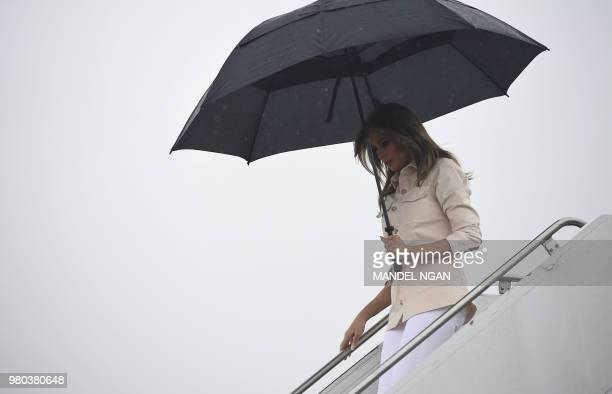 US First Lady Melania Trump steps off a plane upon arrival at McAllen Miller International Airport in McAllen Texas on June 21 2018 Melania Trump is...