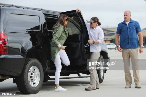 S first lady Melania Trump steps out of her motorcade before boarding an Air Force plane and traveling to Texas to visit facilities that house and...