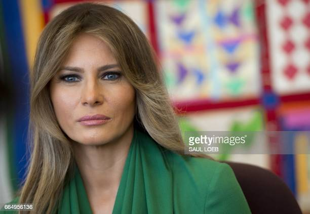 First Lady Melania Trump talks with students during a visit with Jordan's Queen Rania to the Excel Academy Public Charter School in Washington, DC,...