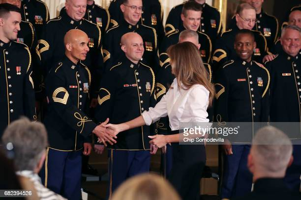 S first lady Melania Trump thanks members of the US Army Chorus during an event honoring military mothers on National Military Spouse Appreciation...