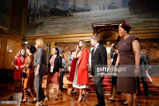 US First Lady Melania Trump the husband of the German Chancellor Joachim Sauer and partners of G20 participants attend the partners' programme at the...