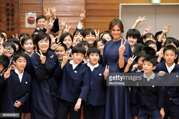 S First Lady Melania Trump third right and Akie Abe wife of Japan's Prime Minister Shinzo Abe third left pose for photographs with students during a...