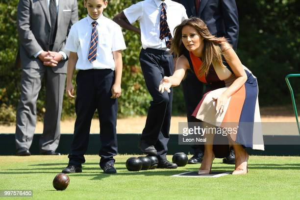 First Lady, Melania Trump, tries her hand at bowls as she meets British Army veterans, known as Chelsea Pensioners, at Royal Hospital Chelsea on July...