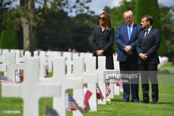 US First Lady Melania Trump US President Donald Trump and French President Emmanuel Macron visit graves after a FrenchUS ceremony at the Normandy...