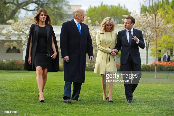 US first lady Melania Trump US President Donald Trump Brigitte Macron and French President Emmanuel Macron walk across the South Lawn before...
