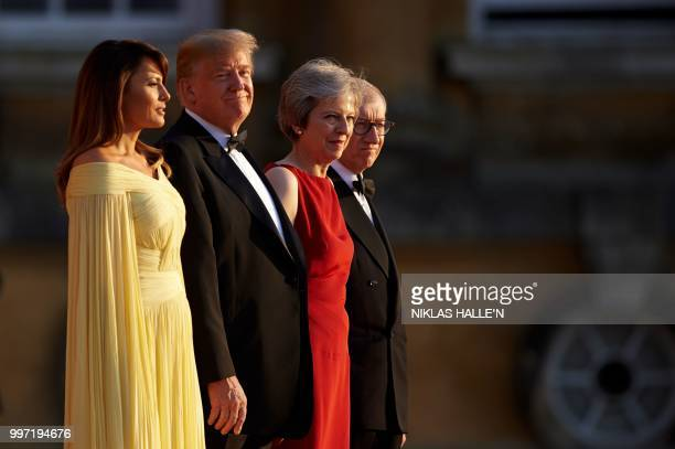 US First Lady Melania Trump US President Donald Trump Britain's Prime Minister Theresa May and her husband Philip May stand on the steps in the Great...