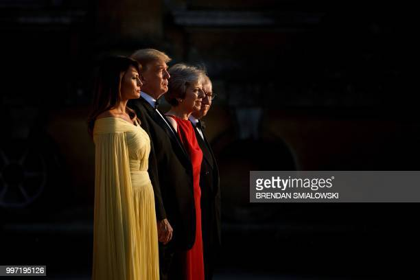 TOPSHOT US First Lady Melania Trump US President Donald Trump Britain's Prime Minister Theresa May and her husband Philip May stand on the steps in...