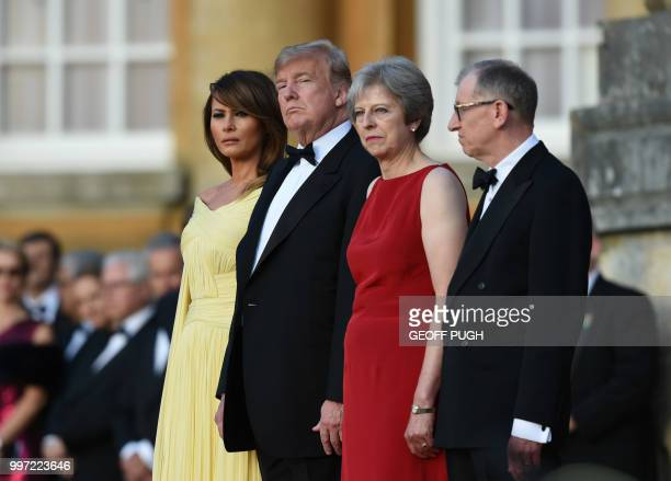 US First Lady Melania Trump US President Donald Trump Britain's Prime Minister Theresa May and her husband Philip May stand on steps in the Great...