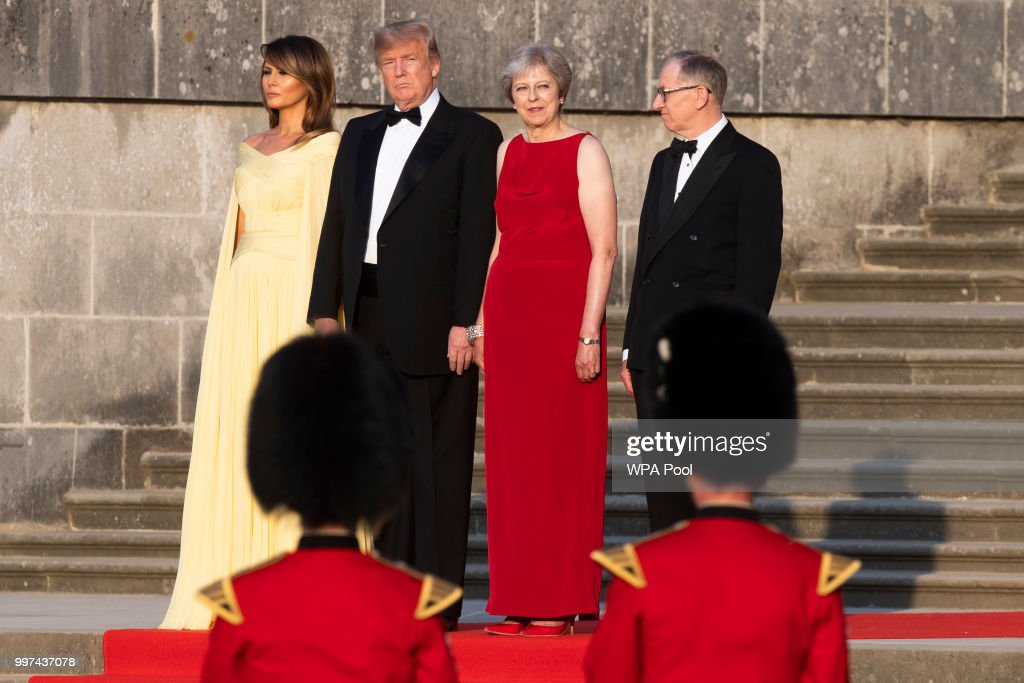 First Lady Melania Trump, U.S. President Donald Trump, British Prime Minister Theresa May and her husband Philip May watch a military band at Blenheim Palace ahead of a dinner with business leaders at Blenheim Palace on July 12, 2018 in Woodstock, England. Blenheim Palace is the birth place of the great wartime British Prime Minister, Winston Churchill, of whom the President is a big fan. The Prime Minister hosted dinner for the President and First Lady and business leaders as part of the First Couple's official visit to the UK.