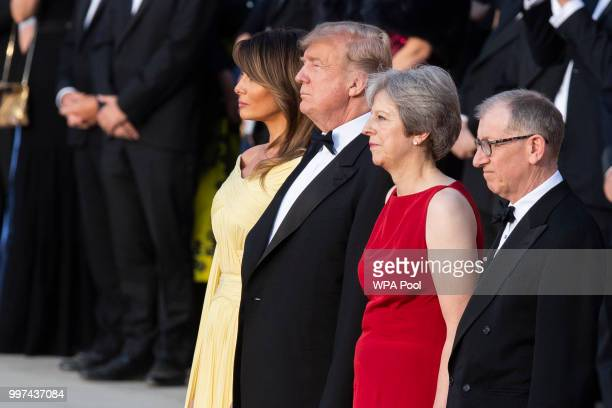 First Lady Melania Trump US President Donald Trump British Prime Minister Theresa May and her husband Philip May watch a military band at Blenheim...
