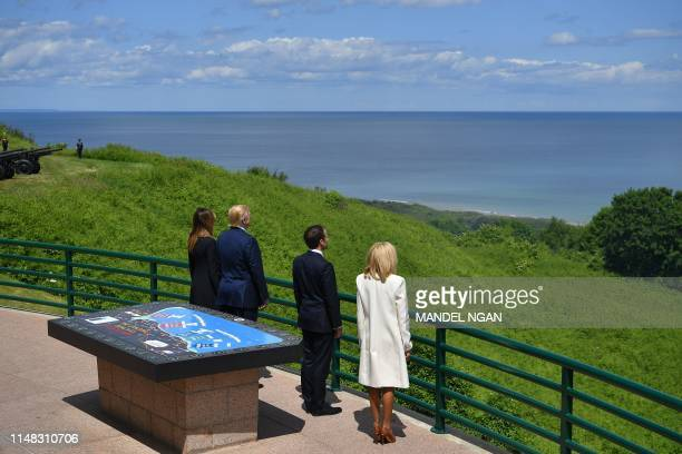 US First Lady Melania Trump US President Donald Trump French President Emmanuel Macron and French President's wife Brigitte Macron look out at the...