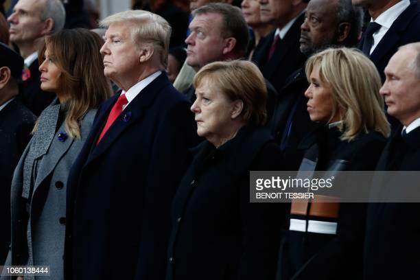 US First Lady Melania Trump US President Donald Trump German Chancellor Angela Merkel French President's wife Brigitte Macron and Russian President...