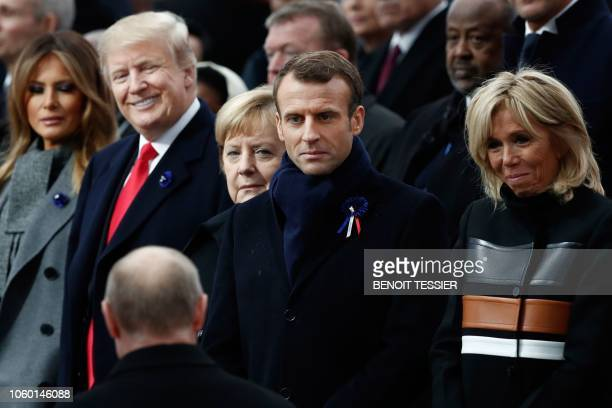 TOPSHOT US First Lady Melania Trump US President Donald Trump German Chancellor Angela Merkel French President Emmanuel Macron and French President's...