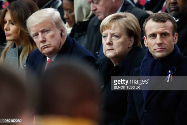 First Lady Melania Trump, US President Donald Trump, German Chancellor Angela Merkel and French President Emmanuel Macron attend a ceremony at the...