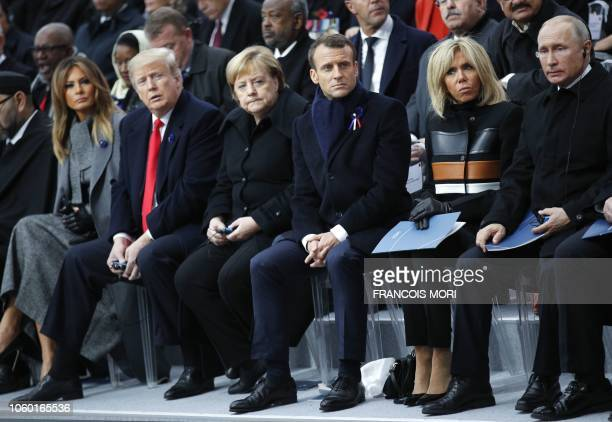 US First Lady Melania Trump US President Donald Trump German Chancellor Angela Merkel French President Emmanuel Macron and his wife Brigitte Macron...