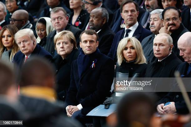 US First Lady Melania Trump US President Donald Trump German Chancellor Angela Merkel French President Emmanuel Macron French President's wife...