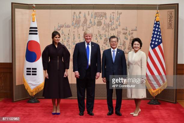 US First Lady Melania Trump US President Donald Trump South Korean President Moon JaeIn and his wife Kim Jungsook pose prior to their meeting at...