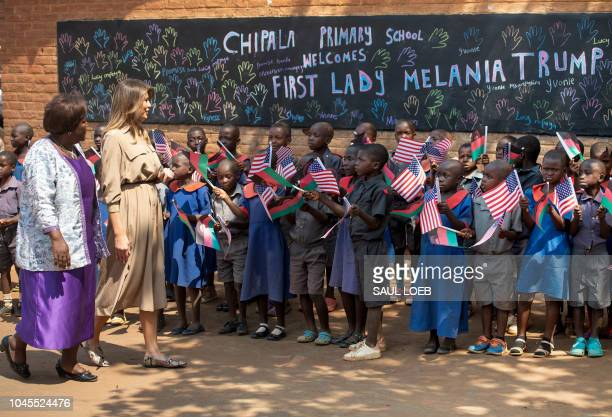 US First Lady Melania Trump visits Chipala Primary School alongside head teacher Maureen Masi on October 4 2018 during a 1day visit in Malawi part of...