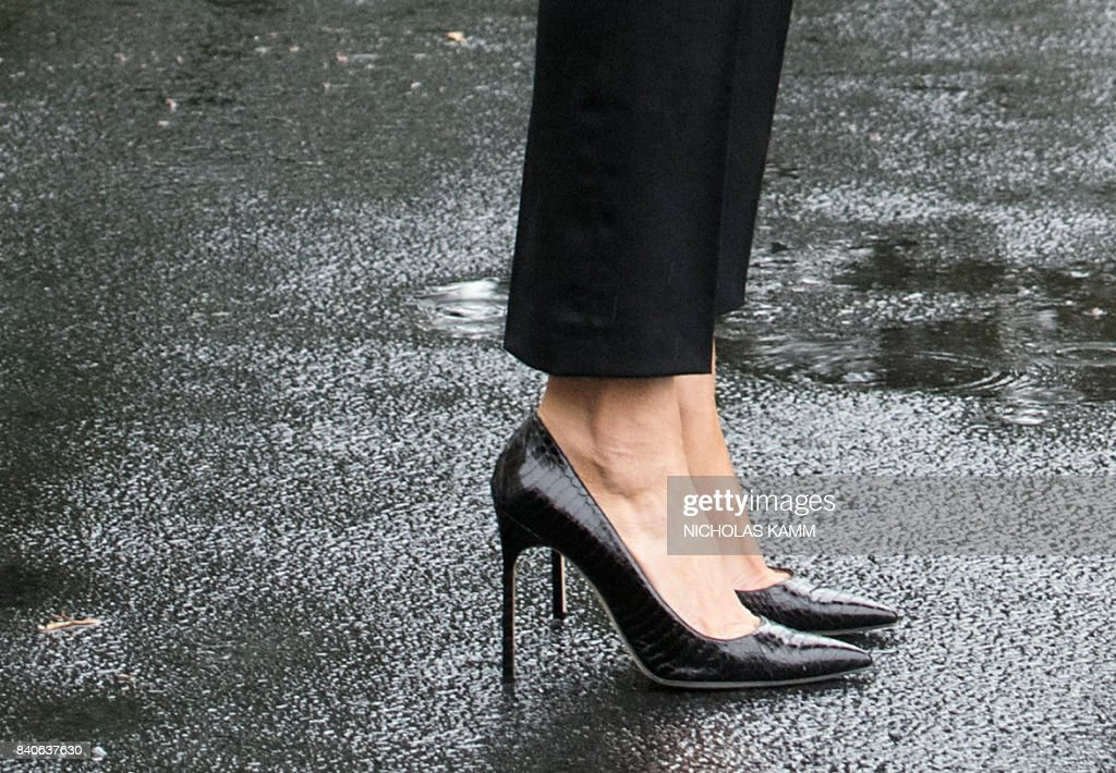 US First Lady Melania Trump waits to board Marine One as she and her husband US President Donald Trump depart the White House in Washington, DC, on August 29, 2017 for Texas to view the damage caused by Hurricane Harvey. First Lady Melania Trump is making waves ... for her flood fashion. The former model is always elegantly turned out and perfectly coiffed, and Tuesday was no exception as she left the White House with her president husband for storm-ravaged Texas. /