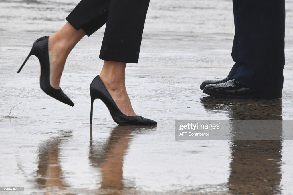 TOPSHOT - First Lady Melania Trump walks on high heels to board Air Force One at Andrews Air Force Base, Maryland, on August 29, 2017 en route to Texas to view the damage caused by Hurricane Harvey. /