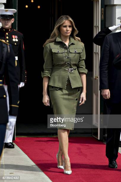 US First Lady Melania Trump walks out of the South Portico of the White House with US President Donald Trump not pictured to greet Mauricio Macri...