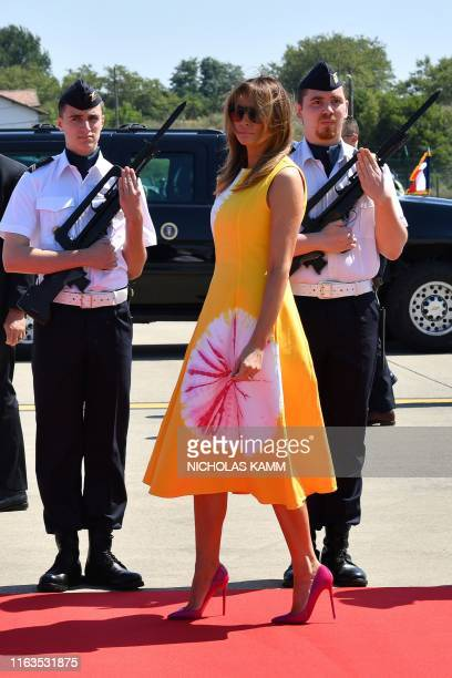 First Lady Melania Trump walks past French airforce soldiers after disembarking from an airplane upon landing at the Biarritz Pays Basque Airport in...