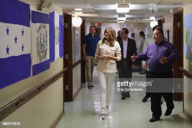S first lady Melania Trump walks through the facility with program director Rogelio de la Cerda Jr after a round table discussion with doctors and...