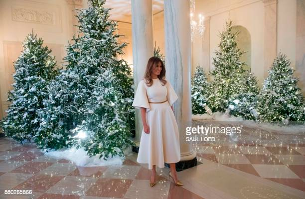 US First Lady Melania Trump walks through the Grand Foyer as she tours Christmas decorations at the White House in Washington DC November 27 2017 /...
