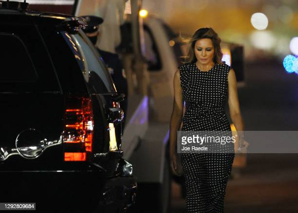 First Lady Melania Trump walks to the vehicle after arriving on Air Force One at the Palm Beach International Airport on December 23, 2020 in West...