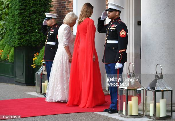 US First Lady Melania Trump walks with Britain's Camilla Duchess of Cornwall ahead of a dinner at Winfield House the residence of the US Ambassador...