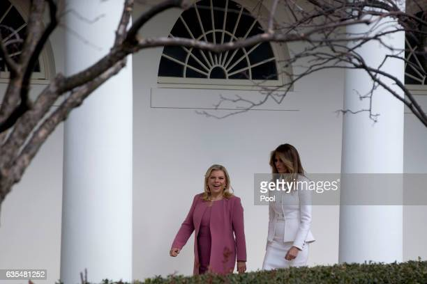 US first lady Melania Trump walks with Sara Netanyahu wife of Israeli Prime Minister Benjamin Netanyahu through the Colonnade of the White House...