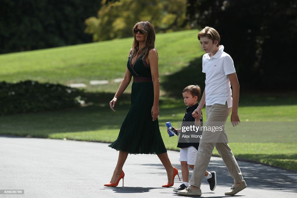 U.S. first lady Melania Trump (L) walks with son Barron (R), and grandson Joseph Frederick Kushner (2nd L) towards the Marine One on the South Lawn of the White House prior to a departure August 25, 2017 in Washington, DC. President Trump is spending the weekend with his family at Camp David.