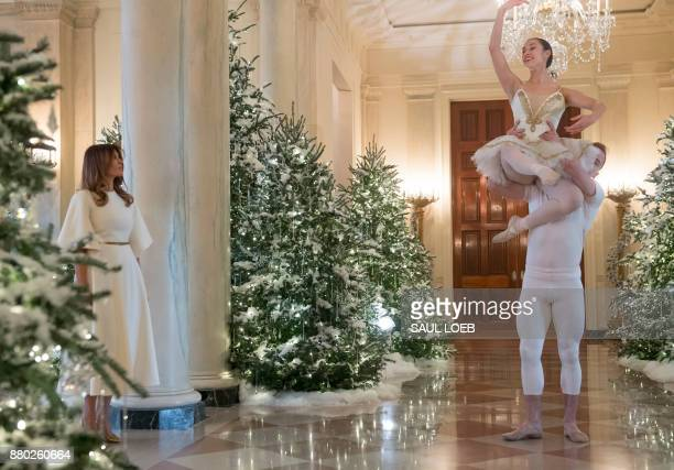 US First Lady Melania Trump watches a ballet performance in the Cross Hall as she tours Christmas decorations at the White House in Washington DC...
