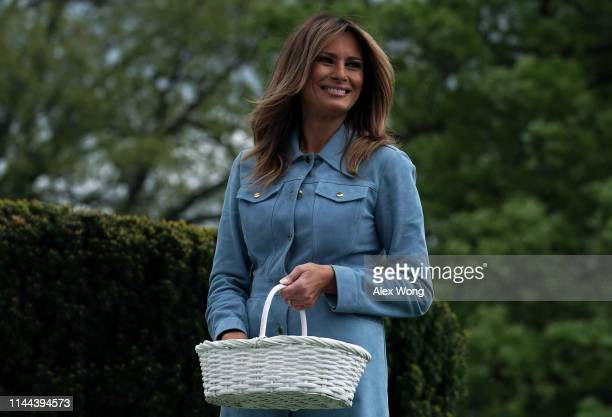 First lady Melania Trump watches children participating in the 141st Easter Egg Roll on the South Lawn of the White House April 22, 2019 in...