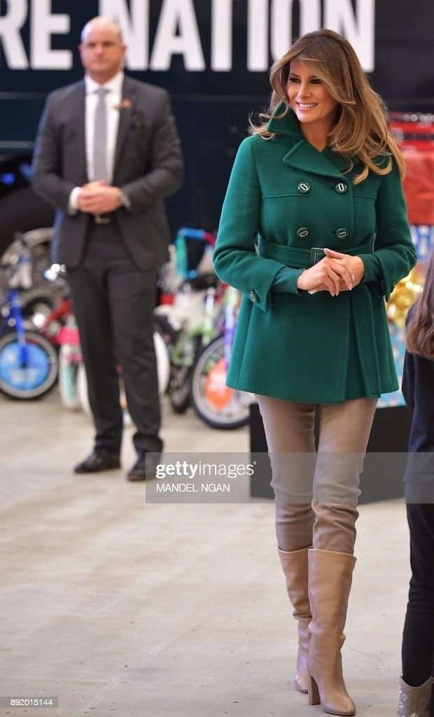 US First Lady Melania Trump watches children sort toys for the Marine Corps Reserve Toys for Tots Campaign at Joint Base Anacostia-Bolling in Washington, DC on December 13, 2017 /