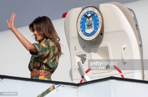US First Lady Melania Trump waves as she boards her military airplane prior to departing from Jomo Kenyatta International Airport in Nairobi October...