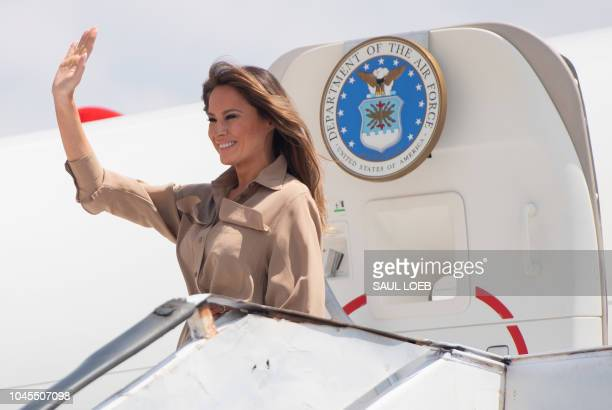 US First Lady Melania Trump waves as she disembarks from her military airplane upon arrival at Lilongwe International Airport October 4 2018 for a...