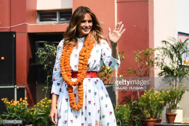 US First Lady Melania Trump waves at students as she visits Sarvodaya CoEd Senior Secondary School in New Delhi on February 25 2020