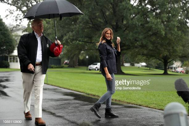 S first lady Melania Trump waves to members of the press as she and President Donald Trump leave the White House October 15 2018 in Washington DC The...