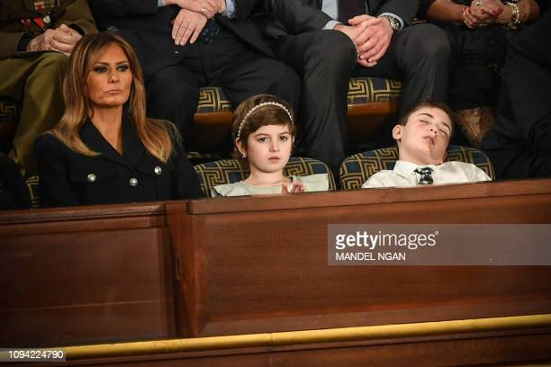 First lady Melania Trump with Grace Eline and Joshua Trump special guests of President Donald Trump look during of the State of the Union address at...
