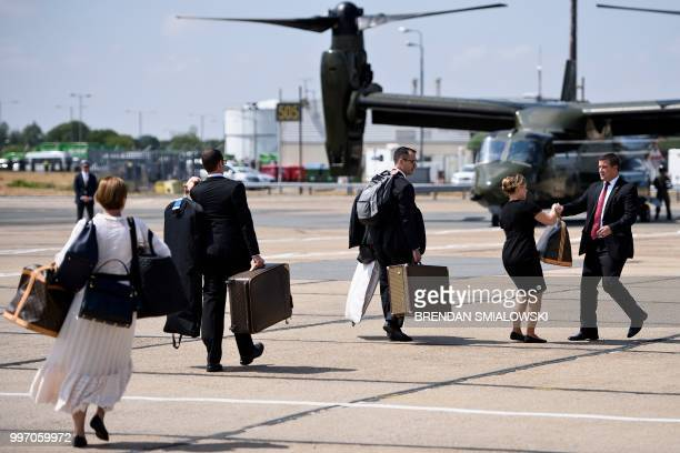 US first lady Melania Trump's chief of staff Lindsay Reynolds follows luggage to helicopters at London Stansted Airport north of London on July 12...