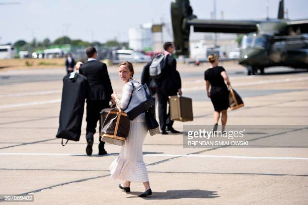 US first lady Melania Trump's chief of staff Lindsay Reynolds walks to helicopters at London Stansted Airport north of London on July 12 2018 The...