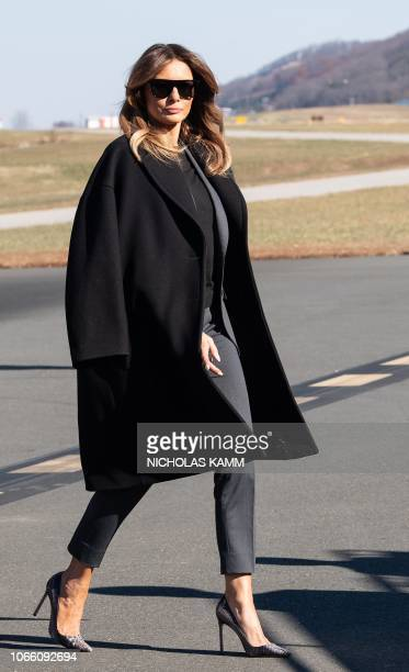 US First Lady Melania Trumps walks to board her plane after participating in a roundtable discussion on opioids at Liberty University in Lynchburg...
