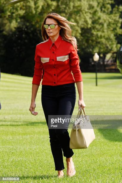 First Lady Melanie Trump walks from Marine One upon arrival on the South Lawn of the White House in Washington DC September 10 after spending the...