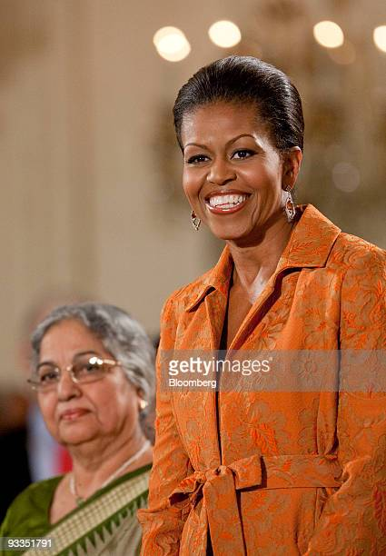 US First Lady Michele Obama right and Gursharan Kaur wife of Indian Prime Minister Manmohan Singh look towards the audience during a ceremony in the...